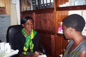 Sr. Angela Rweyora, attending to a Patient