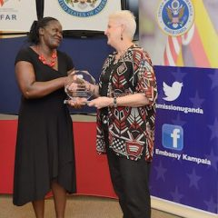 Florence Kintu recieves an award from the US Ambassador to Uganda, Deborah R. Malac