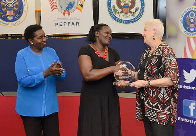 Kintu Florence (Middle), Head of Nursing Sr. Masiira (Left) recieving her award from the US ambassador, Deborah R. Malac
